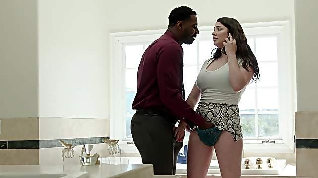 Appealing brunette works huge black dick while screaming